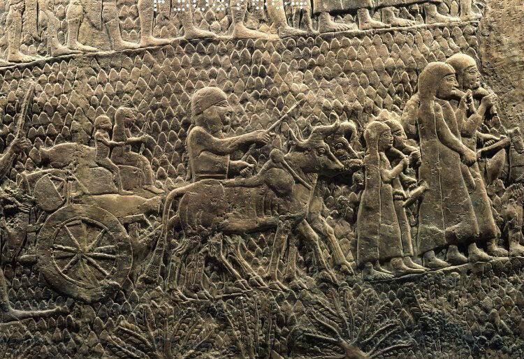 Εικ. 1. Οικογένειες Ιουδαίων αιχμαλώτων οδηγούνται μαζί με τα αγαθά τους και τα οικόσιτα ζώα τους (λεπτομέρεια από το ανάγλυφο της Λαχίς). Βρετανικό Μουσείο, Λονδίνο.